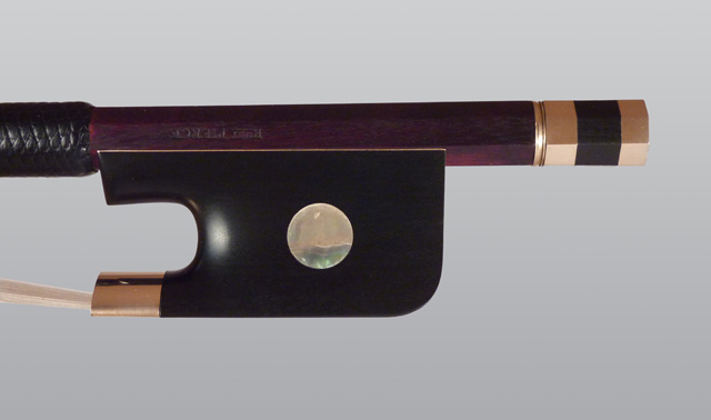 Gold and ebony cello bow frog
